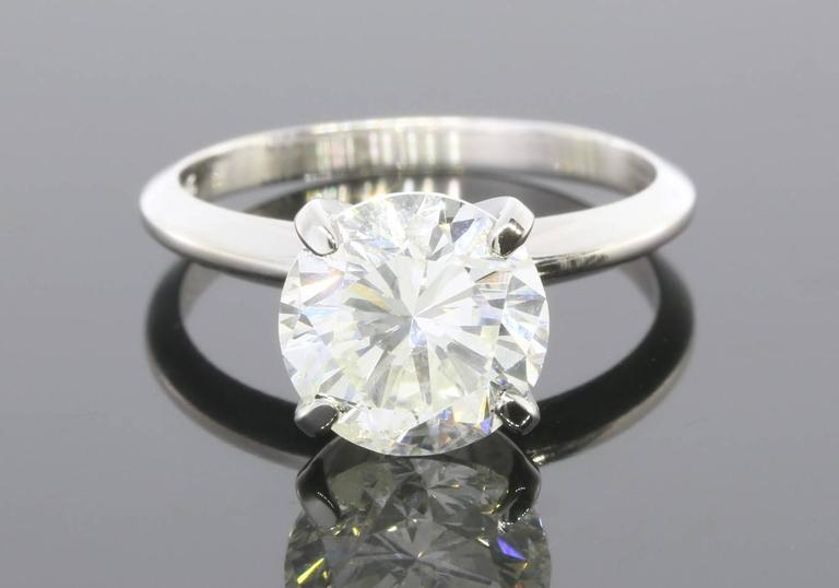 Classic perfection is the best way to describe this magnificent diamond solitaire! This timeless, 14 karat white gold solitaire features a stunning 3.08 carat round brilliant diamond. This fiery beauty is GIA certified as a J/I1 in quality. The ring
