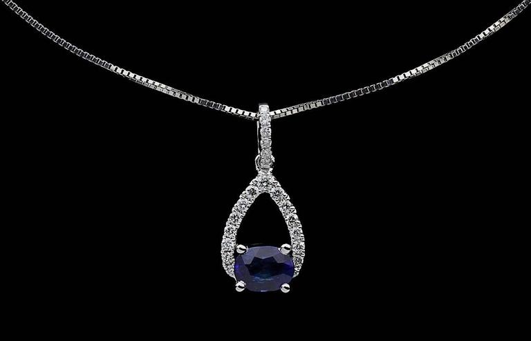 Simple yet elegant & beautiful would be the best way to describe this stunning necklace! It features a .45 carat, oval cut, natural, blue sapphire that is prong set oriented horizontally. The pendant also features sparkly, round brilliant cut