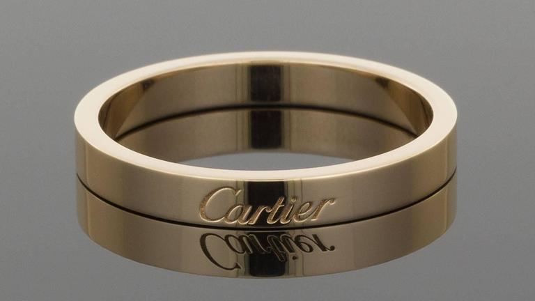 Cartier 18 karat pink gold 3mm signature engraved wedding band ring cartier had its beginning in paris in 1847 has grown into a name that is junglespirit Image collections