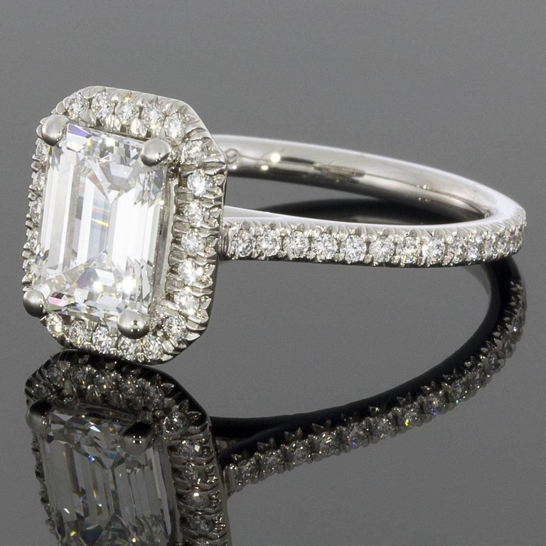 Take her breath away with this spectacular 1.88CTW diamond ring from Martin Flyer! This 65 year old, third generation family owned business handcrafts all their rings with extraordinary attention to detail, using only the highest quality, Hearts