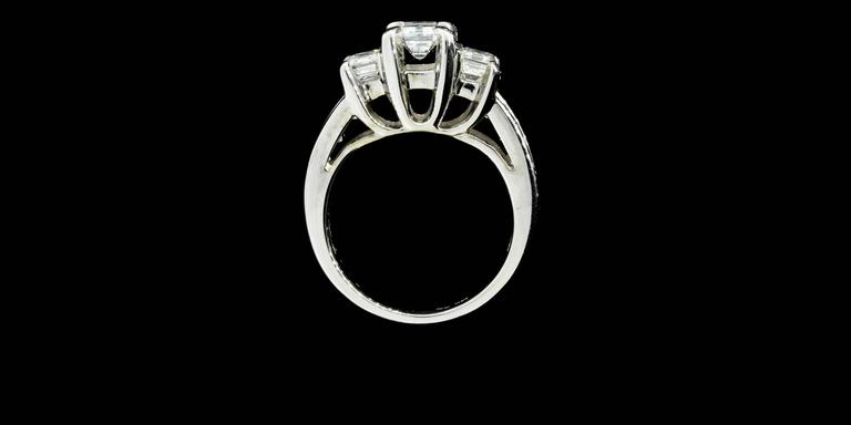 Three-Stone Emerald Cut Diamond Gold Engagement Ring 4