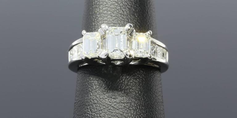 Three-Stone Emerald Cut Diamond Gold Engagement Ring 6