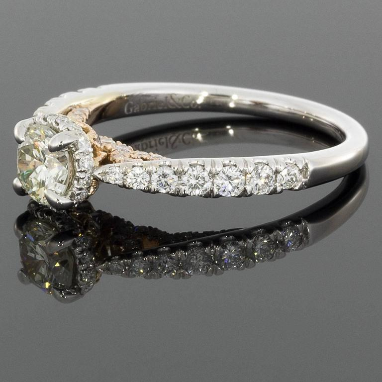 This lovely diamond engagement ring from Gabriel & Co features a 1.09 combined total carat weight in sparkly, round brilliant diamonds. The center diamond weighs .51 carat & grades as J/VS2 in quality. This fiery center diamond is prong set