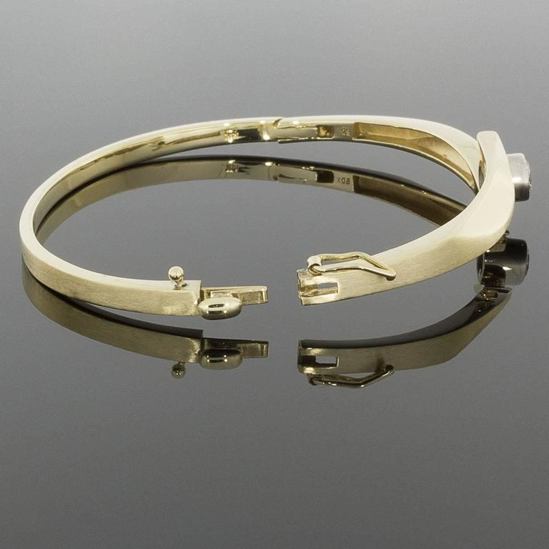 braceletgoldtone bracelet narrow bangle jewelry kors goldtone metallic hinged gold lyst michael in product gallery