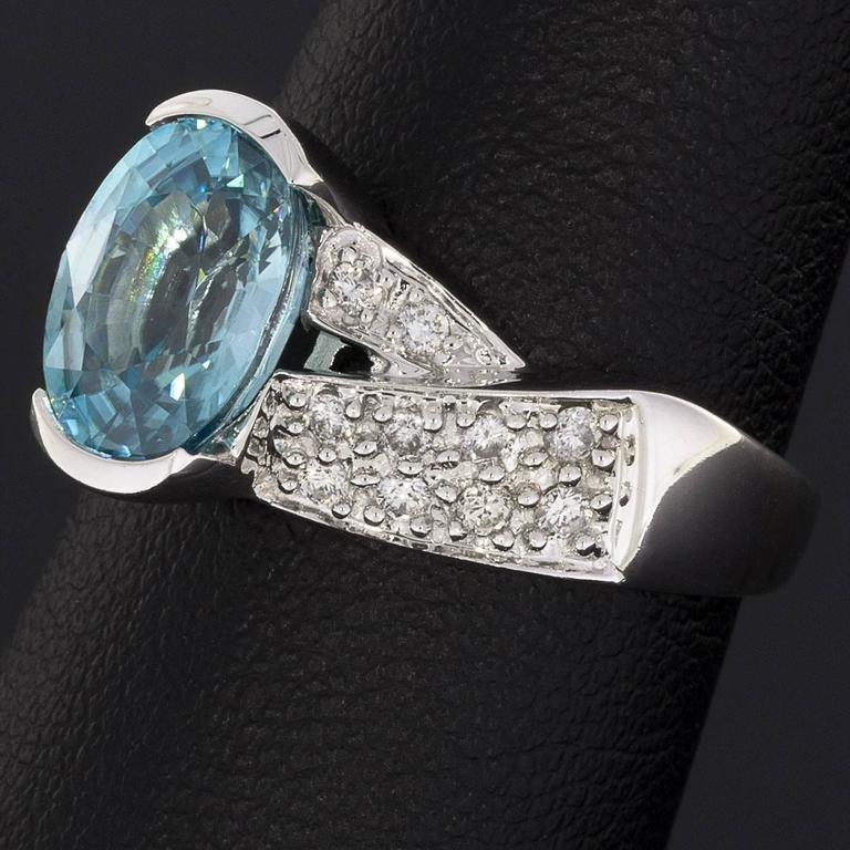 4 carat oval blue zircon pave white gold twist