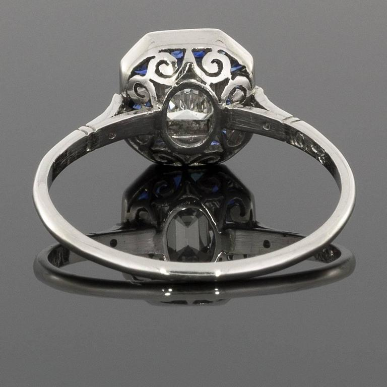 emerald cut diamond sapphire platinum halo engagement ring
