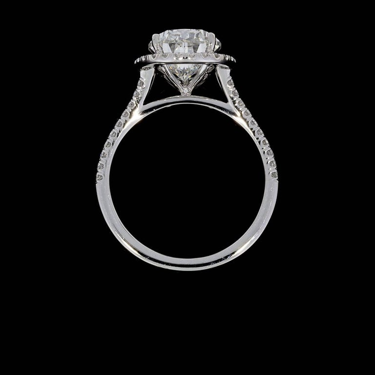 3.96 Carat Platinum Certified Pear Diamond Halo Engagement Ring In As New Condition For Sale In Columbia, MO