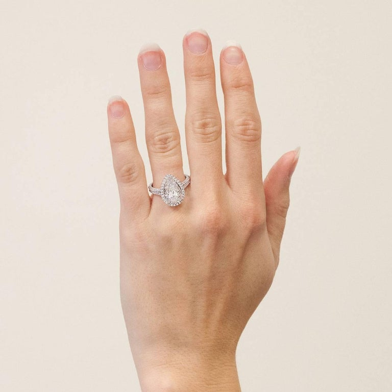 3.96 Carat Platinum Certified Pear Diamond Halo Engagement Ring For Sale 2