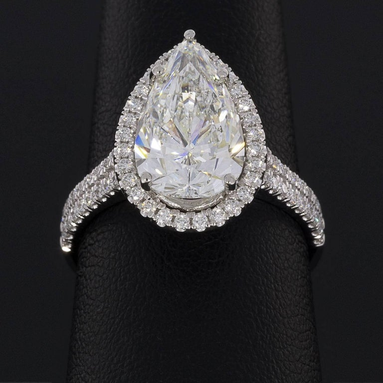 Women's 3.96 Carat Platinum Certified Pear Diamond Halo Engagement Ring For Sale
