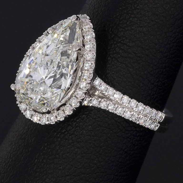 3.96 Carat Platinum Certified Pear Diamond Halo Engagement Ring For Sale 1