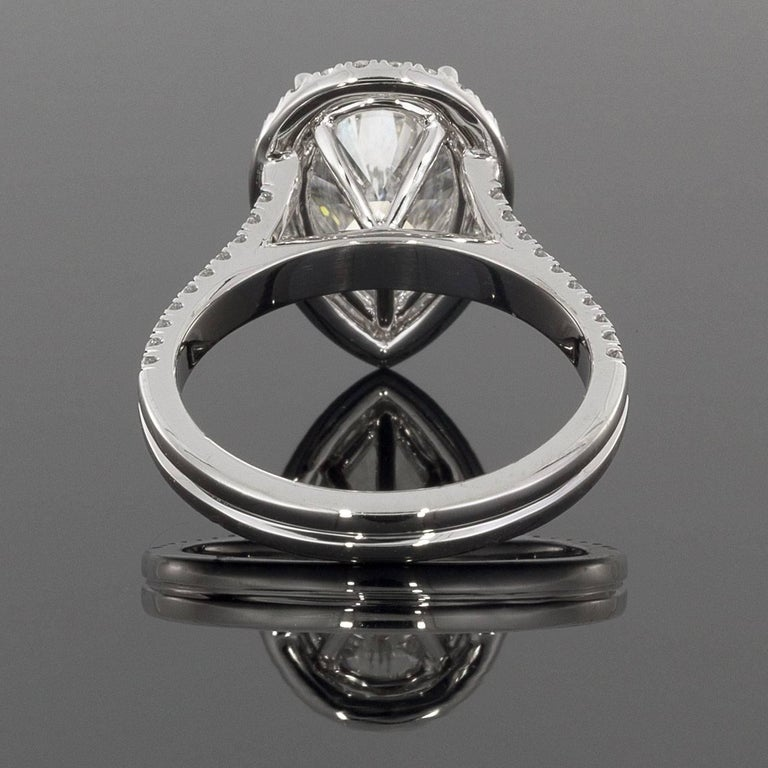Pear Cut 3.96 Carat Platinum Certified Pear Diamond Halo Engagement Ring For Sale