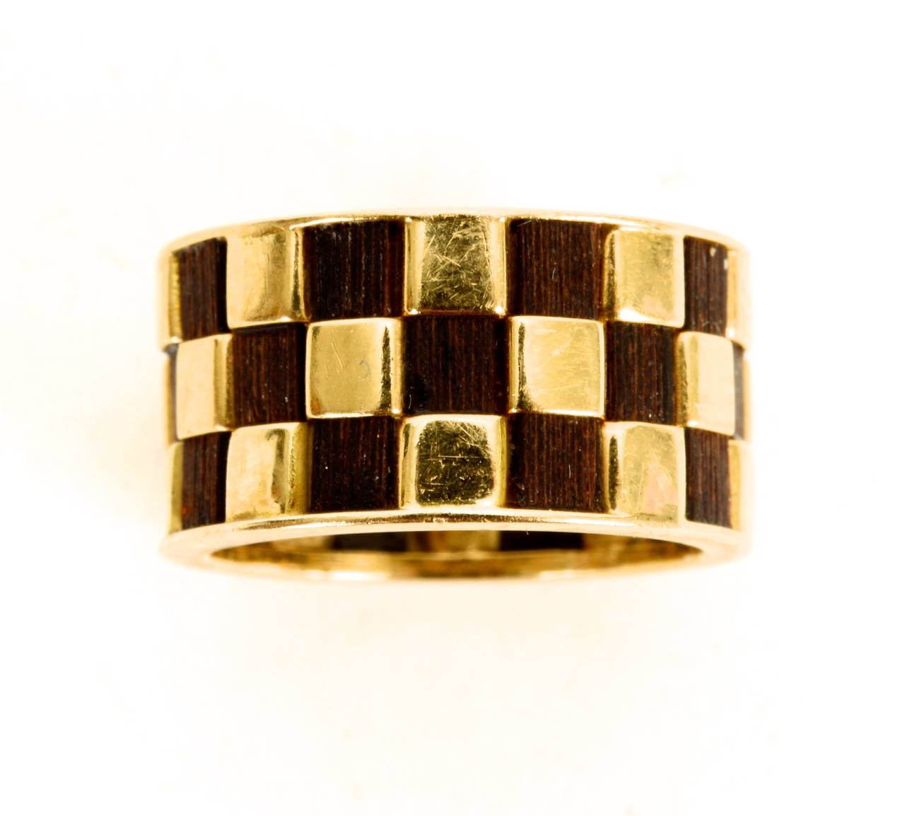 A 18kt gold and ebony band in a Checkerboard Design,