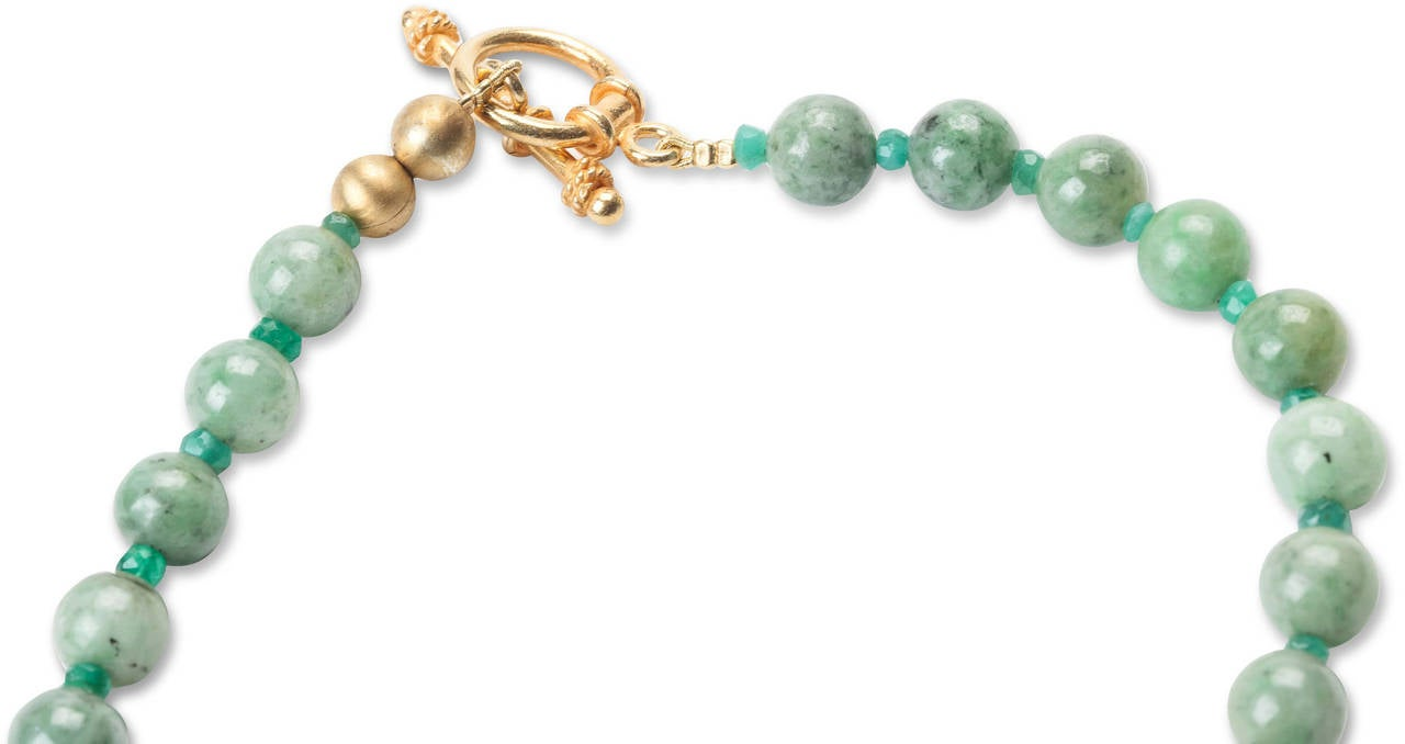 Carved jade barrel necklace with 8mm jade beads, faceted emerald spacers and a vermeil toggle clasp.