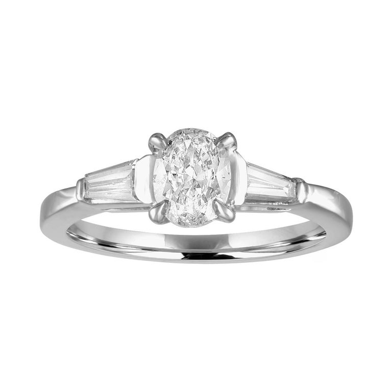 0.51 Carat Oval Diamond Platinum Engagement Ring For Sale