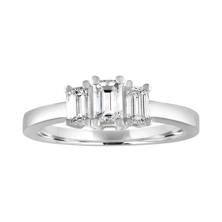 0.90 Carat Emerald Cut Diamond Three Stone Platinum Ring