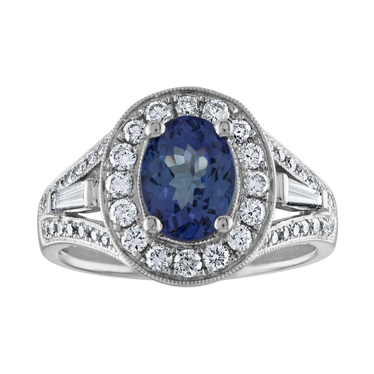 1.80 Carat Oval Tanzanite Diamond Halo Gold Ring For Sale