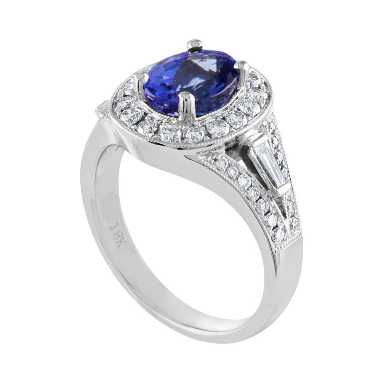 Beautiful Oval Tanzanite Halo Ring The ring is 18K White Gold The Oval Tanzanite is 1.80 Carats There are 0.80 Carats in Diamonds G/H VS The ring is a size 6.00, sizable. The ring weighs 6.8 grams.