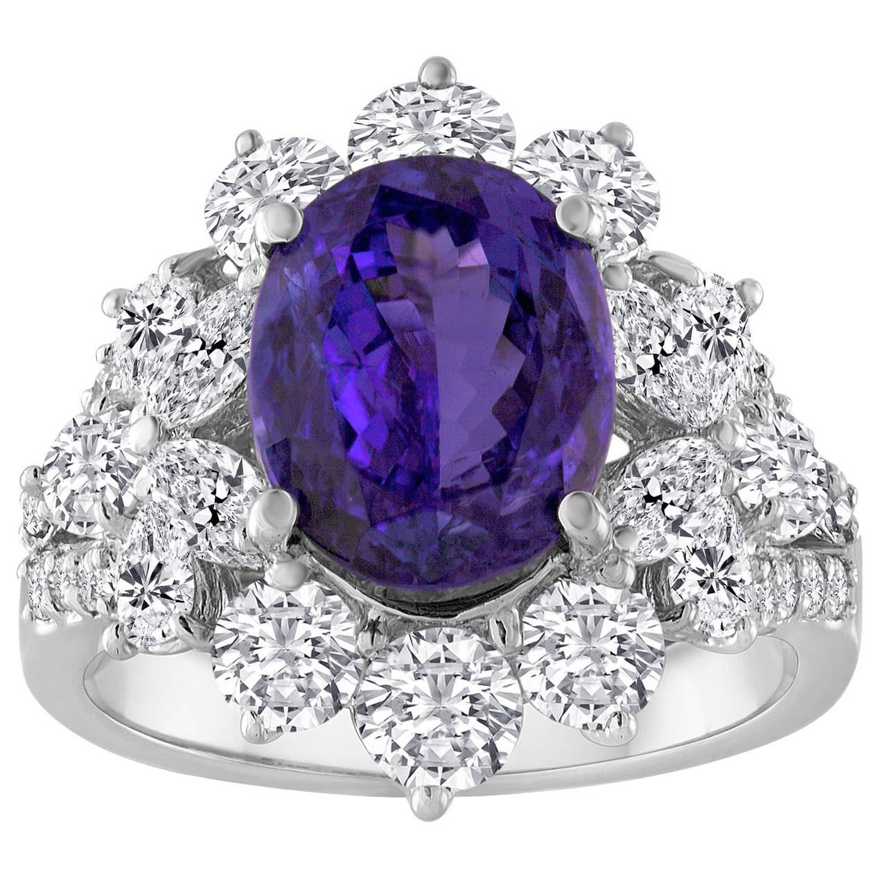 4.10 Carat Oval Cut Tanzanite and Diamond18K Gold Ring