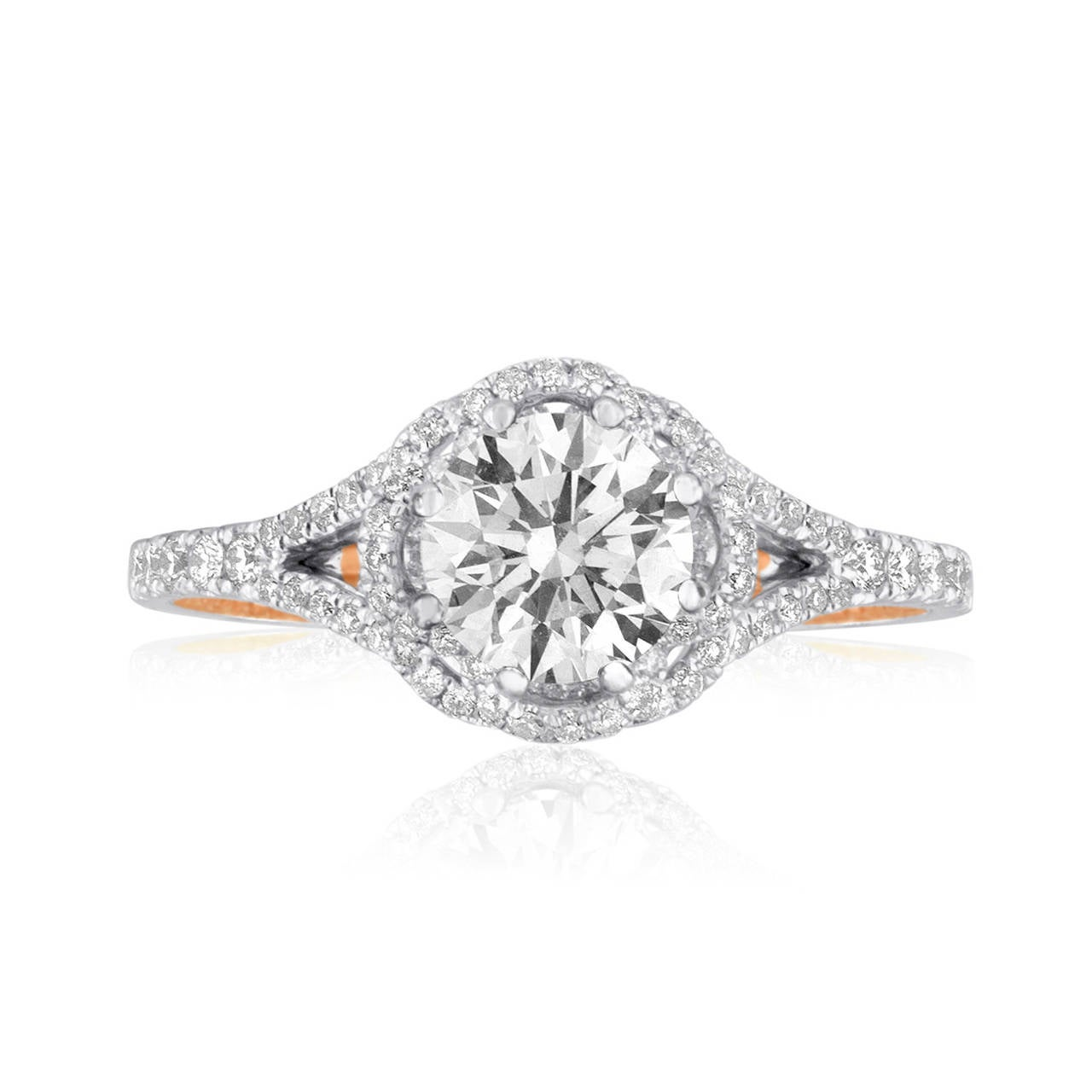 Stunning one of a kind diamond engagement ring. The ring is 18K Rose Gold and White Gold The ring has 0.68ct in small white diamonds G SI. The center diamond is GIA 1.08ct F VVS1 XXX. The ring weighs 3.5 grams. The ring is a size 6.5, cannot be