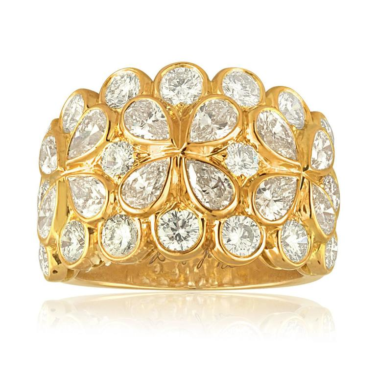 The ring is 18K Yellow Gold. There are 4.25ct in Diamonds F VVS. The ring has French Maker Marks on the outside of the ring. The ring comes with Certificate of Authenticity. The ring is a size 6.5, not sizable. The ring weighs 12.3 grams. An elegant