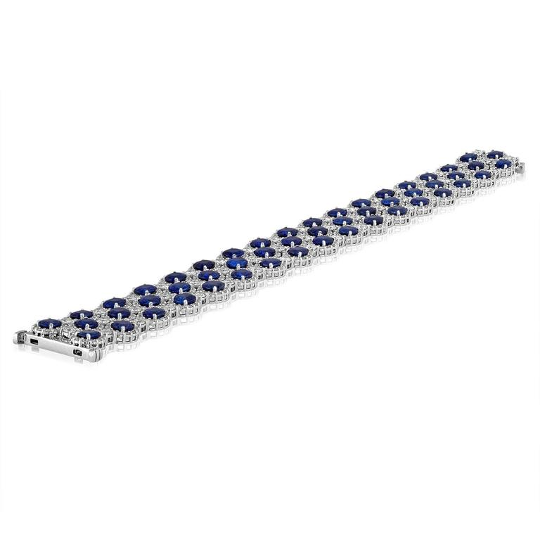 "Classic Sapphire & Diamond Bracelet The Bracelet has 22.10Ct in Blue Sapphires Surrounded by 8.48CT in Diamonds F/G SI The stones are set in 18K White Gold The bracelet is 7"" Length & 10/16"" Wide. The bracelet weighs 34.0 grams"
