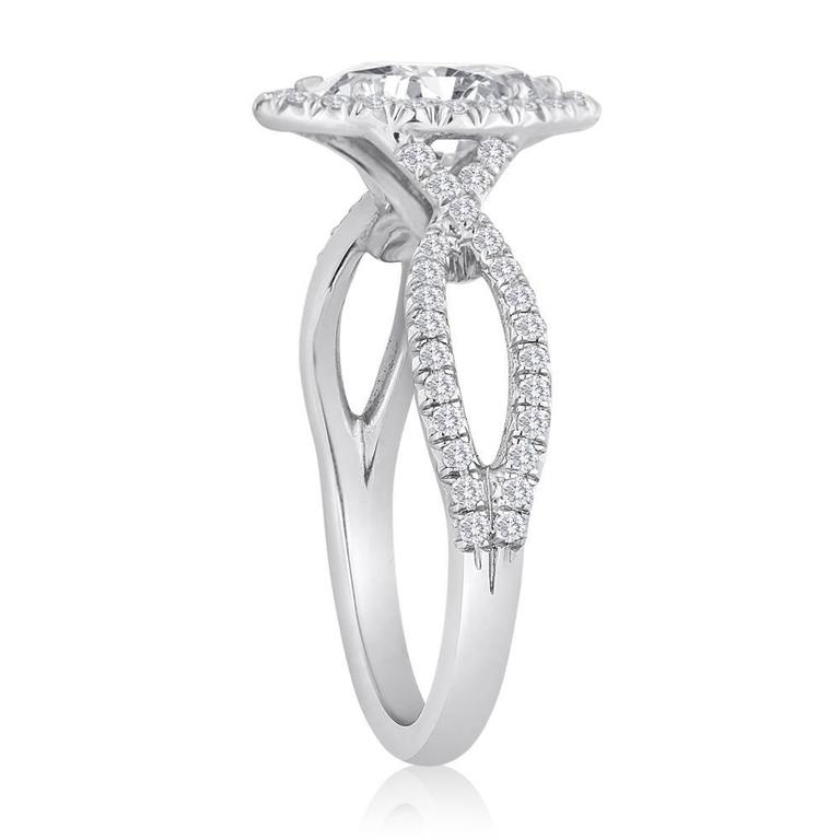 Marquise Halo Engagement Ring The ring is 18K White Gold  GIA Certified 0.74 Carat D SI2 Marquise Cut There is 0.37 Carats F VS The ring is a size 5.5, sizable. The ring weighs 3.4 grams