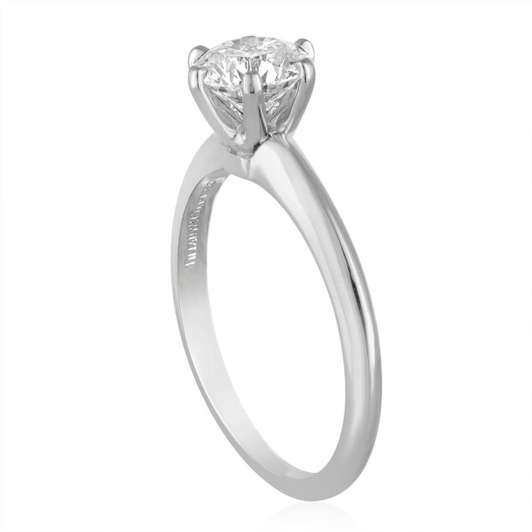 Tiffany & Co. Solitaire Engagement Ring. The stone is GIA certified 1.19Ct F VS1 XXX. Tiffany & Co. serial Number etched on the crown. The stone is set in PLT/950. The ring comes with a GIA certificate. The ring is a size 7.5, sizable. The ring