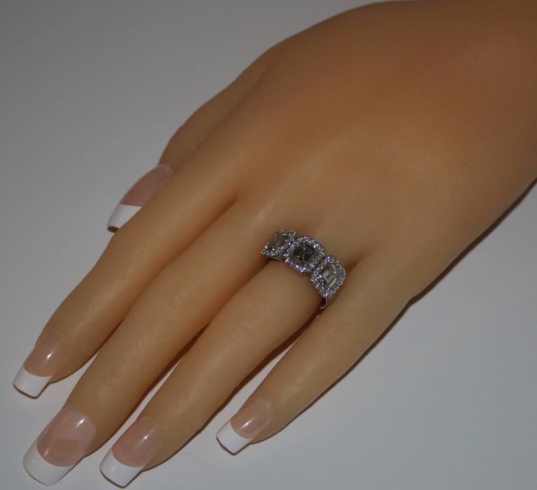 Modern 2.80 Carats Diamond Three Stone Emerald Cut Gold Ring For Sale