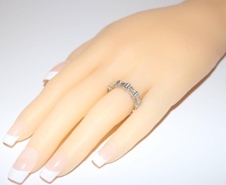 Modern 4.39 Carats Diamond Emerald Cut Platinum Eternity Band Ring For Sale