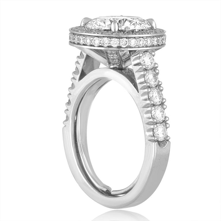 Beautiful Diamond Engagement Ring The ring is Platinum 950 The center is stone is GIA Certified 3.01 Carats I VS1 Round Diamond There are 1.23 Carats in Small Diamonds H/I VS The ring is a size 4.5-5.0, not sizable. The ring weighs 11.4 grams