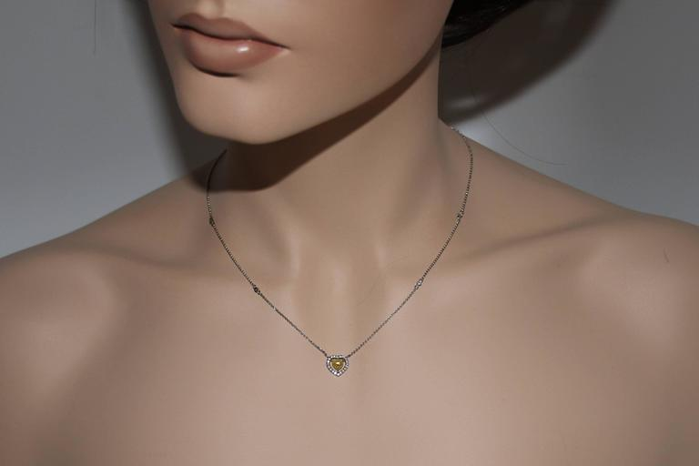 Contemporary 0.48 Carats Fancy Yellow Heart Shape Diamond Halo Necklace For Sale