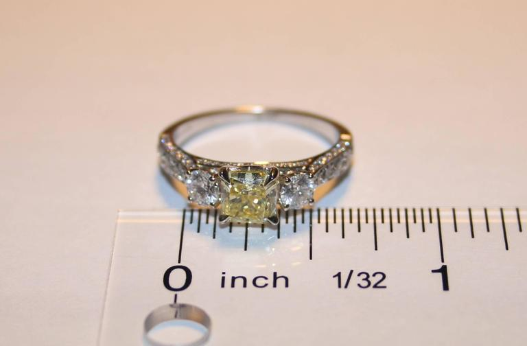 GIA Certified 0.91 Carat Fancy Intense Yellow Diamond Three Stone Gold Ring In New Condition For Sale In New York, NY