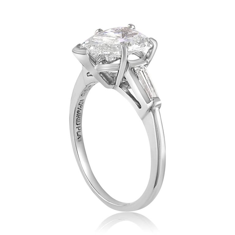 Pear Shape Engagement Ring The ring is Platinum The center Stone is 1.41 Carats G/H I1 There are 2 Tapered Baguettes 0.18 Carats H/I VS1/VS2 The ring is certified by IGI. The ring is a size 5.75, sizable. The ring weighs 3.5 grams