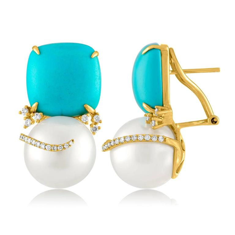 Beautiful & Fun Earrings. The earrings are 18K Yellow Gold. There are 0.50 Carats in Diamonds F/G VS. The South Sea Pearls are 13mm in Diameter. The earrings measure 1