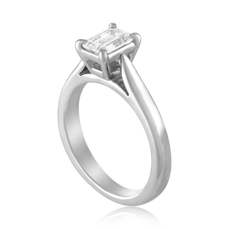 Solitaire Engagement Ring The ring is Platinum The center Is Emerald Cut Stone GIA Certified 0.71 Carat D VVS1 The ring is a size 4.75, sizable. The ring weighs 6.3 grams