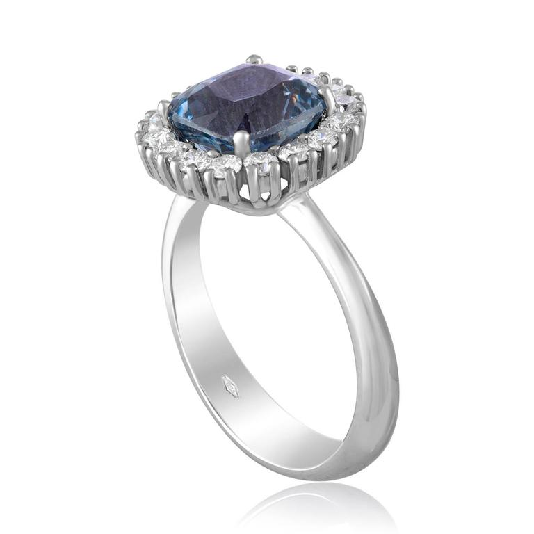 Beautiful Cushion Halo Ring. The ring is 18K White Gold. The center stone is a cushion 3.97 Carat Grayish Blue-Violet Sapphire. The Sapphire is NO HEAT and is certified by AGL.  The ring has 0.54 Carats F/G VS. The top of the ring measures 0.50