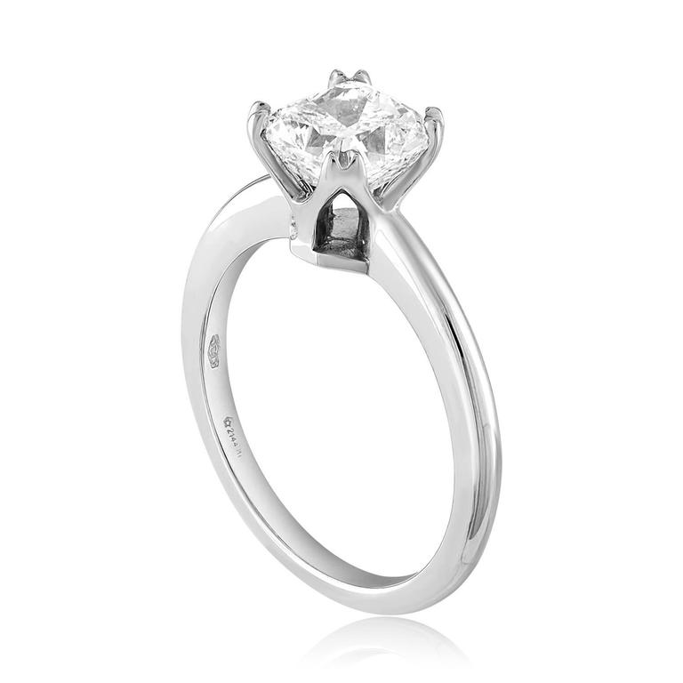 Solitaire Engagement Ring The ring is 18K White Gold The center Is Cushion Cut Stone, GIA Certified 1.70Ct G VS1 The ring is a size 6.5, sizable. The ring weighs 3.9 grams