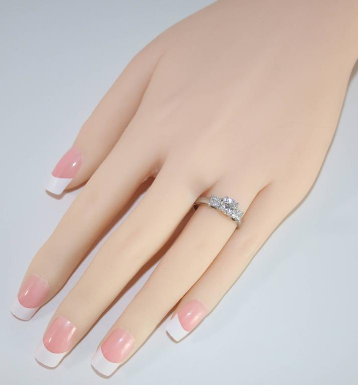 Contemporary GIA Certified 0.90 Carat H VS2 Diamond Three Stone Platinum Ring For Sale