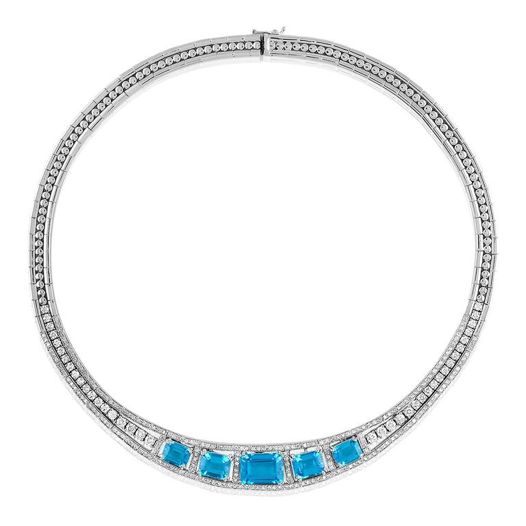 Stunning 3-Piece Set The set consists of 1 Bracelet, 1 Necklace, & 1 Pair of Earrings  The necklace is 18K White Gold There are 5.32 Carats in Diamonds G SI There are 24.67 Carats in Blue Topaz The necklace is 16