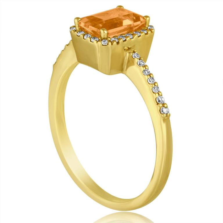 Stunning Step Cut Citrine Ring The ring is 14K Yellow Gold There are 0.14 Carats In Diamonds H SI The Center Stone is a Step Cut Citrine 0.81 Carat The top measures 1/4