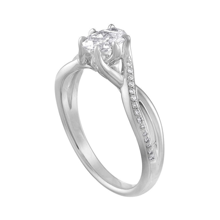 Stunning Engagement Ring With Crisscross Split Shank. The ring is 14K White Gold. The center Diamond Stone is an Oval Cut 0.52 Carats I VVS. There are 0.25 Carats in small round diamonds F VS. The total weight of all diamonds is 0.77 Carats. The