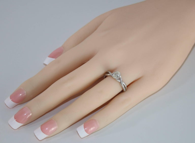 Contemporary 0.52 Carat Diamond Gold Oval Engagement Ring