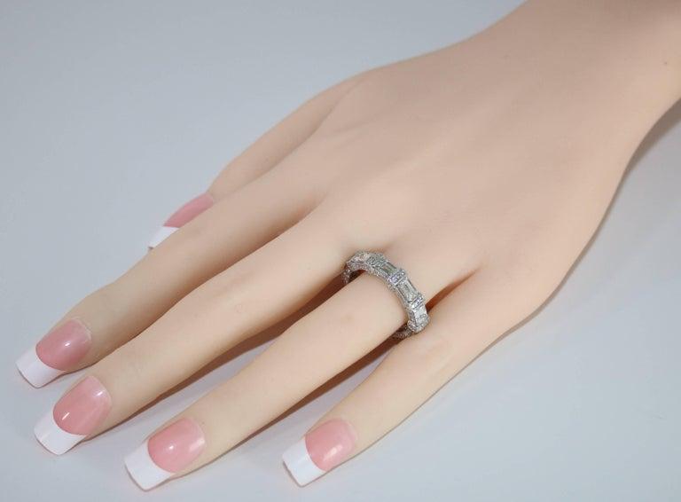 Contemporary 5.18 Carat Emerald Cut Eternity Diamond Platinum Band For Sale