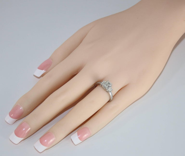 Contemporary GIA Certified 1.16 Carat G VVS2 Diamond Three Stone Gold Ring For Sale