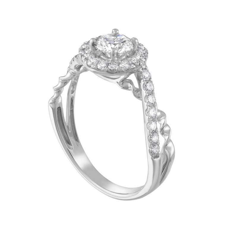 The ring is 18K White Gold. The center stone is a Round 0.55 Carats H VVS2 GIA Certified. The setting has 0.50 Carats in White Diamonds G/H SI. The ring is a size 7, sizable. The ring weighs 3.2 grams.