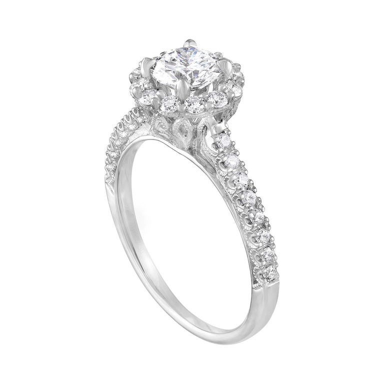 The ring is 18K White Gold, Milgrain Design. The center stone is a Round 0.80 Carats E VVS1 GIA Certified. The setting has 0.45 Carats in White Diamonds G/H SI. The ring is a size 7.25, sizable. The ring weighs 3.9 grams.