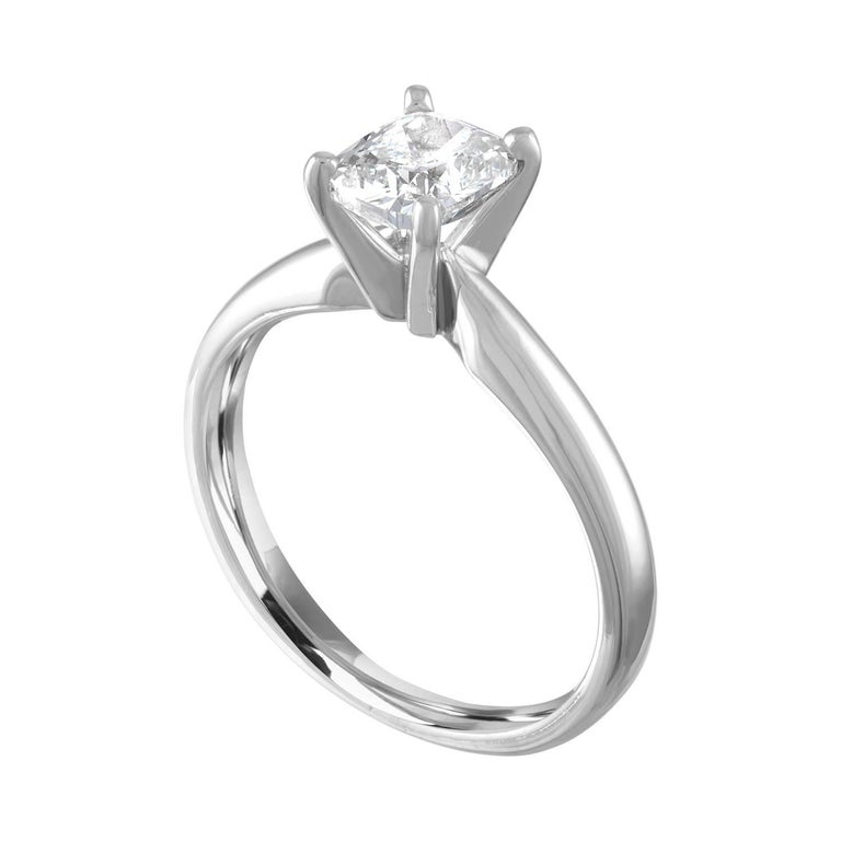 Solitaire Engagement Ring. The ring is Platinum 950. The Diamond is Cushion Cut, GIA Certified 0.79Ct H VS1. The ring is a size 5.00, sizable. The ring weighs 4.3 grams.