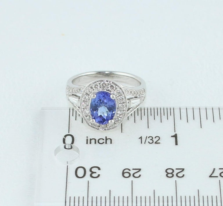 1.80 Carat Oval Tanzanite Diamond Halo Gold Ring For Sale 1