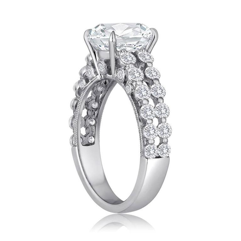 Cushion Cut Diamond set in 18K White Gold Setting with Double Row of Diamonds