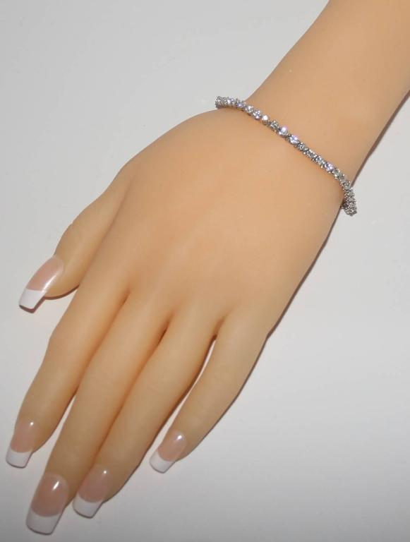 Beautiful Diamond Tennis Bracelet in 14K White Gold. This is a 3 prong tennis bracelet. There are 45 round stones. Each stone is approximately 0.11ct G/H Color VS/SI Clarity 4.97 Total Carat Weight The bracelet is 7